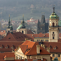Standing on a higher viewpoint you realize that there are many churches and towers in Prague.