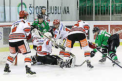 27.02.2015, Hala Tivoli, Ljubljana, SLO, EBEL, HDD Telemach Olimpija Ljubljana vs HC TWK Innsbruck, 6. Qualification Round, in picture Ales Music (HDD Telemach Olimpija, #16) vs Patrick Machreich (HC TWK Innsbruck, #33) during the Erste Bank Icehockey League 6. Qualification Round between HDD Telemach Olimpija Ljubljana and HC TWK Innsbruck at the Hala Tivoli, Ljubljana, Slovenia on 2015/02/27. Photo by Morgan Kristan / Sportida
