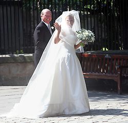 FILE PHOTO - Zara Phillips and Mike Tindall are expecting a baby in the New Year, Buckingham Palace announced today.<br /> Queen Elizabeth II's granddaughter Zara married England rugby star Tindall in July 2011 at Edinburgh's Canongate Kirk and a reception at the Queen's Scottish residence, the Palace of Holyrood<br /> <br /> Wedding of Zara Phillips and Mike Tindall at Canongate Kirk Church, Edinburgh, Saturday July 30th 2011. Photo by : Stephen Lock / i-Images