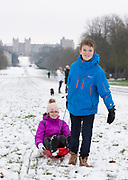UNITED KINGDOM, Windsor: 01 February 2019. <br /> Twins Millie Wellington 12 (pink) and Joe Wellington 12 (blue) enjoy the snow along The Long Walk in Windsor this morning. A number of schools, including their school of St Edwards Middle School were closed today because of the adverse weather. <br /> Rick Findler / Story Picture Agency