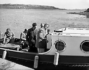 Lord and Lady Mountbatten at Mullaghmore, Co. Sligo, looking over their new craft. Mountbatten, along with members of his family and a local boy, died when the IRA blew up this boat in 1979..30.07.1960