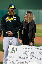OAKLAND, CA - JUNE 14:  Sean Doolittle #62 of the Oakland Athletics and girlfriend Eireann Dolan stand on the field during a ceremony honoring victims of the Orlando terror attack before the game against the Texas Rangers at the Oakland Coliseum on June 14, 2016 in Oakland, California. The Texas Rangers defeated the Oakland Athletics 10-6. (Photo by Jason O. Watson/Getty Images) *** Local Caption *** Sean Doolittle; Eireann Dolan