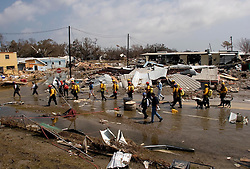 26th Sept, 2005. Hurricane Rita aftermath, Cameron, Louisiana. Members of the Las Vegas, Nevada Task Force 1, a FEMA search and rescue team scour the destroyed remains of houses and business in Cameron, Louisiana for any signs of life two days after the storm ravaged the small town. FEMA officials meet the rescuers as they arrive.