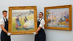 © Licensed to London News Pictures. 29/01/2020. LONDON, UK. Technicians present (L) ''Gelée Blanche, Jeune Paysanne Faisant Du Feu'' by Camille Pissarro, (Est. £8,000,000 - 12,000,000) next to (R) ''La Corne D'Or. Matin'' by Paul Signac, (Est. £5,000,000 - 7,000,000) . Preview of Sotheby's Impressionist & Modern and Surrealist Art sales.  The auction will take place at Sotheby's New Bond Street on 4 and 5 February 2020.  Photo credit: Stephen Chung/LNP