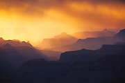 A monsoon storm begins to clear as the sun sets. From the South Rim of Grand Canyon National Park in Arizona.