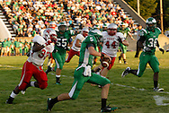Senior Sam Spees (5) with the ball as the Troy Trojans play the Chaminade-Julienne Eagles at the West Carrollton Middle School stadium, Friday, August 26, 2011.
