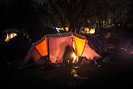 A tent in to wht woods. During the night smuggles have the full control of the camp. Grande Synthe, France. FEDERICO SCOPPA/CAPTA