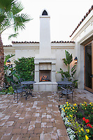 Lit stove in courtyard garden of Palm Springs home