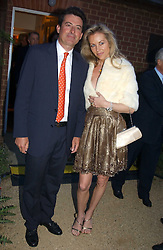 MR NICK BARHAM and SABINA MCTAGGART at the Cartier Chelsea Flower Show dinat the annual Cartier Flower Show Diner held at The Physics Garden, Chelsea, London on 23rd May 2005.<br />