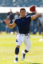 Nov 6, 2011; Oakland, CA, USA; Denver Broncos quarterback Tim Tebow (15) warms up before the game against the Oakland Raiders at O.co Coliseum. Mandatory Credit: Jason O. Watson-US PRESSWIRE