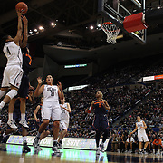 Moriah Jefferson, Connecticut, shoots over Rachel Coffey, Syracuse, during the Connecticut V Syracuse Semi Final match during the Big East Conference, 2013 Women's Basketball Championships at the XL Center, Hartford, Connecticut, USA. 11th March. Photo Tim Clayton