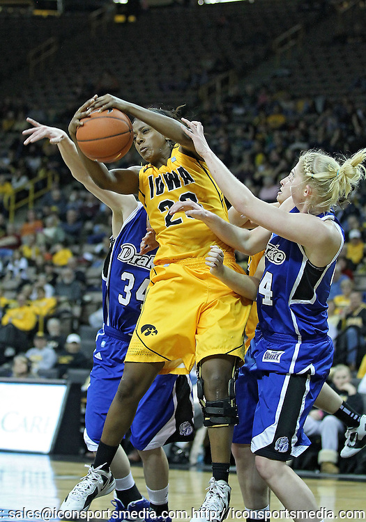 December 20, 2011: Iowa Hawkeyes guard Theairra Taylor (23) tries to pull in a rebound between Drake Bulldogs guard Amber Wollschlager (34) and Drake Bulldogs forward/center Stephanie Running (44) during the NCAA women's basketball game between the Drake Bulldogs and the Iowa Hawkeyes at Carver-Hawkeye Arena in Iowa City, Iowa on Tuesday, December 20, 2011. Iowa defeated Drake 71-46.