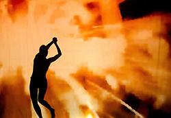 05.05.2011, Ferry Porsche CONGRESS CENTER, Zell am See, AUT, IRONMAN 70.3 Salzburg, im Bild eine weibliche Silhouette beim tanzen, orange Schattenspiele während der Präsentations- Pressekonferenz des Ironman 70.3 Zell am See Kaprun, der am 26. August 2012 erstmals über die Bühne geht // a female silhouette dancing, orange, EXPA Pictures © 2011, PhotoCredit: EXPA/ J. Feichter