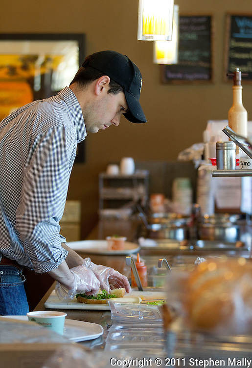 Owner Ryan Buresh prepares a sandwich for a customer at The Prairie Soup Company in Cedar Rapids on Friday, November 11, 2011. (Stephen Mally/Freelance)