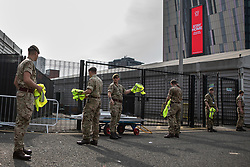 © Licensed to London News Pictures. 10/04/2020. Manchester, UK. Soldiers from the 1st Battalion the Duke of Lancaster's Regiment arrive to help in the construction . The National Health Service is building a 648 bed field hospital for the treatment of Covid-19 patients , at the historical railway station terminus which now forms the main hall of the Manchester Central Convention Centre . The facility is due to open next week and will treat patients from across the North West of England , providing them with general medical care and oxygen therapy after discharge from Intensive Care Units . Photo credit: Joel Goodman/LNP