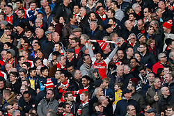a supporters celebrate after Olivier Giroud scores his second goal to make it 2-0 - Photo mandatory by-line: Rogan Thomson/JMP - 07966 386802 - 15/02/2015 - SPORT - FOOTBALL - London, England - Emirates Stadium - Arsenal v Middlesbrough - FA Cup Fifth Round Proper.