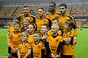 Wolverhampton Wanderers players pose for photos with the mascots during the EFL Sky Bet Championship match between Wolverhampton Wanderers and Fulham at Molineux, Wolverhampton, England on 3 November 2017. Photo by Alan Franklin.