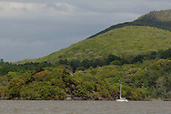 Cornwall-on-Hudson, New York - A sailboat heads north on the Hudson River by Pollepel Island on April 27, 2010.