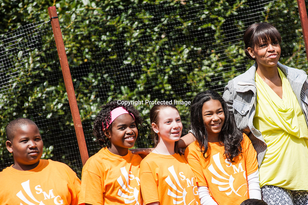 (L-R) Jordan Wilson, Eliza Croom, Kyla Bourne, and Rachel Bradley of Sarah Moore Greene Magnet Technology Academy School, Knox County, TN  pose for a photo with  First Lady Michelle Obama during an event where they planted the White House Kitchen Garden for the fifth year in a row at the White House on April 4, 2013 in Washington DC. Photo by Kris Connor