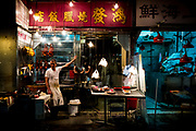 Hong Kong, China - A butcher waits for customers at a shop selling fresh meats at a street market in the Wan Chai district of Hong Kong on April 29,  2018.