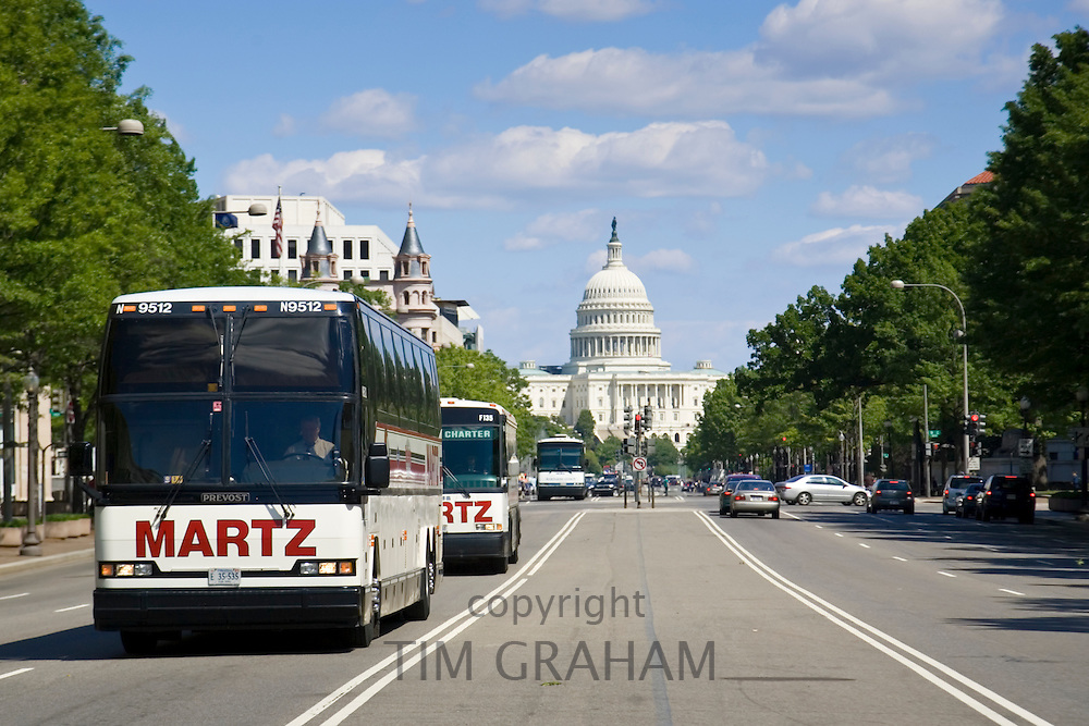 Buses on a Washington DC street with The United States Capitol building in the background, USA