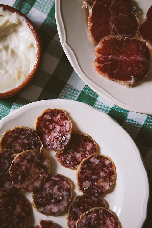 A plate of Iberico Chorizo (bottom left) and a plate Iberico Salchichon. Finca Al Cornocal, Extramadura (Barajoz Province), Spain.
