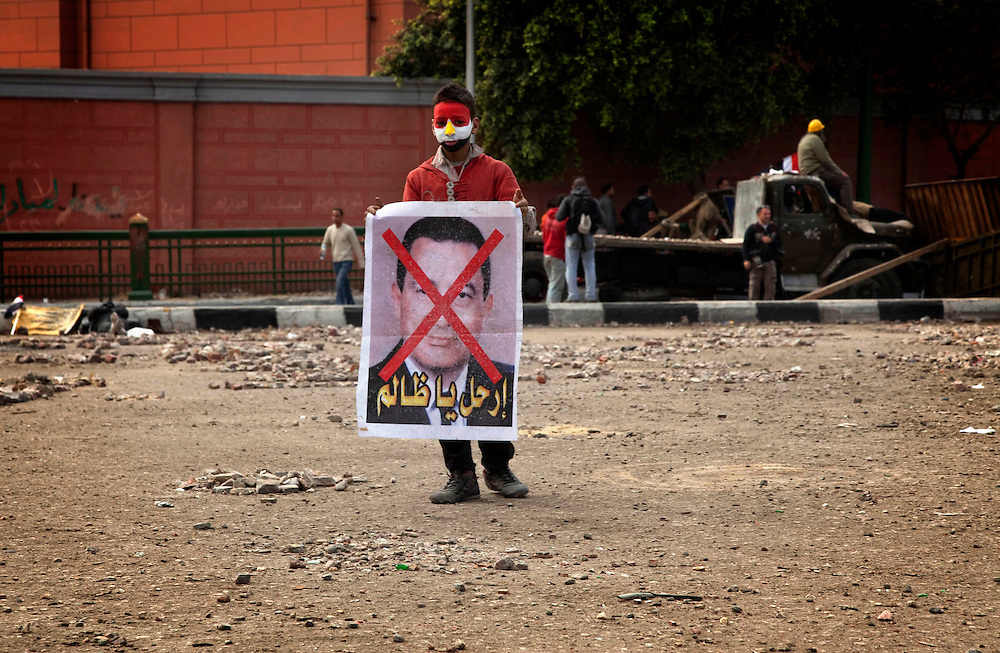 Anti-government protesters gather in Tahrir Square on Sunday, Feb. 6, 2011. The protesters protected themselves from the pro-Mubarak demonstrators with a makeshift barricade, which they defended against the pro-Mubarak crowd.