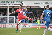 James Bailey (Carlisle United) and Michael Woods (Hartlepool United) jump for the ball during the EFL Sky Bet League 2 match between Hartlepool United and Carlisle United at Victoria Park, Hartlepool, England on 14 April 2017. Photo by Mark P Doherty.