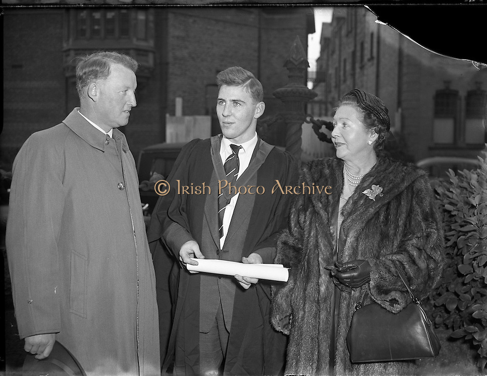 29/10/1955<br /> 10/29/1955<br /> 29 October 1955<br /> <br /> Degree day at UCD, Student posing for a picture after receiving his degree