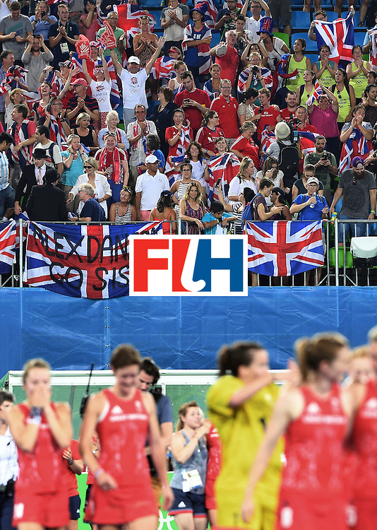 Britain fans celebrate as players leave the pitch after winning the women's semifinal field hockey New Zealand vs Britain match of the Rio 2016 Olympics Games at the Olympic Hockey Centre in Rio de Janeiro on August 17, 2016. / AFP / MANAN VATSYAYANA        (Photo credit should read MANAN VATSYAYANA/AFP/Getty Images)