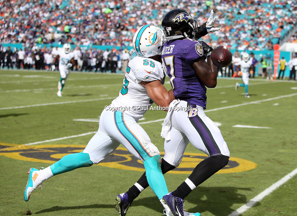 Miami Dolphins outside linebacker Koa Misi (55) breaks up a second quarter deep pass intended for Baltimore Ravens wide receiver Jeremy Butler (17) during the 2015 week 13 regular season NFL football game against the Baltimore Ravens on Sunday, Dec. 6, 2015 in Miami Gardens, Fla. The Dolphins won the game 15-13. (©Paul Anthony Spinelli)