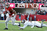 Nov 15, 2014; Tuscaloosa, AL, USA;  Alabama Crimson Tide tight end O.J. Howard (88) is grabbed from behind by Mississippi State Bulldogs defensive back Will Redmond (2) at Bryant-Denny Stadium. Mandatory Credit: Marvin Gentry