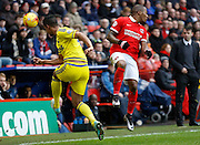 Nottingham Forest defender Michael Mancienne clears despite Charlton Athletic midfielder Callum Harriott jumping to block during the Sky Bet Championship match between Charlton Athletic and Nottingham Forest at The Valley, London, England on 2 January 2016. Photo by Andy Walter.