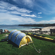 I started my kayaking trip from the Isle of Mull, the second largest island of the Inner Hebrides (after Skye). I camped alongside the grazing cows near Ardmore Point at the northern tip of the island, and spent a week exploring the area in my kayak before making the crossing to the Isle of Coll to the west. I was more accustomed to taking precautions against potentially dangerous brown bears in Alaska than ensuring that grazing cows didn't trample on my tent, so I knew that it was going to be a very different kind of trip. There was a small, well-protected beach sandy beach there along the rocky shoreline of Ardmore Bay that made the launching of my kayak easier. I was going to experience the same problems as in Southeast Alaska where there are very few sandy beaches along the rocky and pebbly coast.