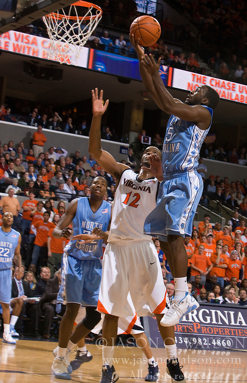 North Carolina guard Ty Lawson (5) shoots over Virginia forward Jamil Tucker (12).  The the #5 ranked North Carolina Tar Heels defeated the Virginia Cavaliers 83-61 in NCAA Basketball at the John Paul Jones Arena on the Grounds of the University of Virginia in Charlottesville, VA on January 15, 2009.