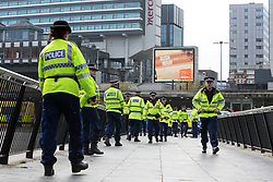© Licensed to London News Pictures . 20/10/2018 . Manchester , UK . Hundreds of police contain approximately 50 EDL supporters in Piccadilly Gardens . Street protest movement , the English Defence League ( EDL ) , hold a demonstration , opposed by anti-fascists , including Unite Against Fascism ( UAF ) , in Manchester City Centre . Amongst the reasons for their protest , the EDL cite news reports that revealed an imam at the Didsbury Mosque where Manchester Arena bomber Salman Abedi prayed , praised armed jihad in a sermon delivered just days before Abedi bought a ticket for the Ariana Grande concert at which he killed twenty two people . Photo credit : Joel Goodman/LNP