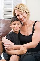 Mother cuddling her son