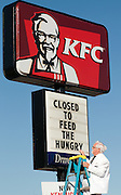"This handout photo from KFC shows Colonel Sanders look-alike Bob Thompson changing the reader board Tuesday, Sept. 29, 2009 in Louisville, Ky., to show that a KFC restaurant has been converted into a ""World Hunger Relief Kitchen"" during the lunch rush to feed residents of the local Wayside Christian Mission. KFCs across the country will be collecting donations for World Hunger Relief now through the end of October. (Photo by Brian Bohannon)."