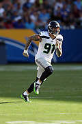 Seattle Seahawks defensive end Cassius Marsh (91) chases the action during the 2017 NFL week 1 preseason football game against the against the Los Angeles Chargers, Sunday, Aug. 13, 2017 in Carson, Calif. The Seahawks won the game 48-17. (©Paul Anthony Spinelli)