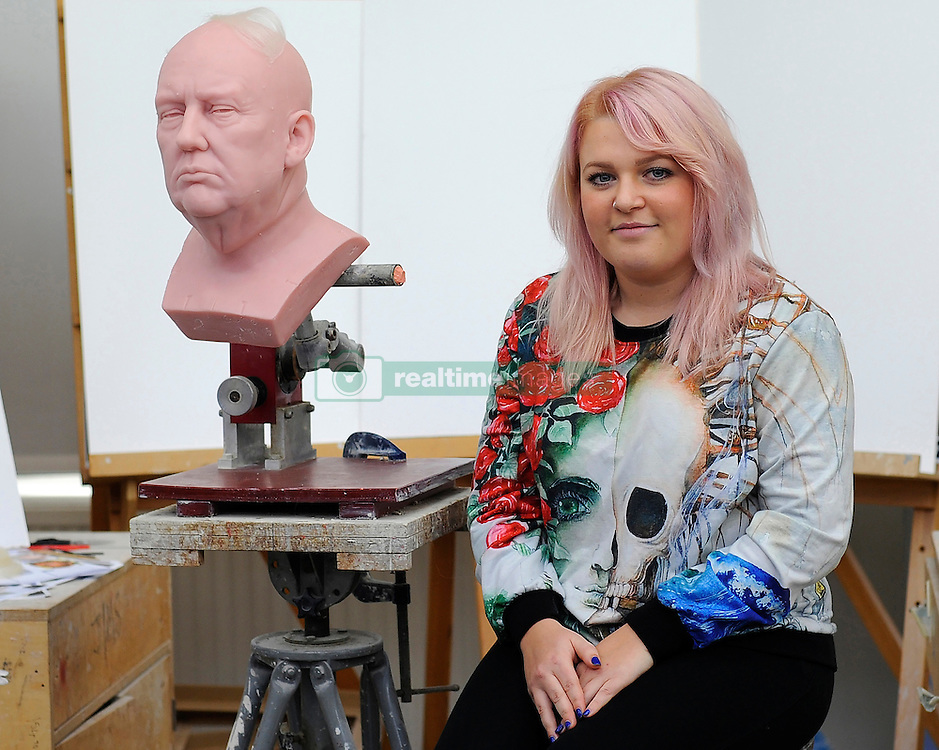 Sophie Crudgington with an unfinished wax figure of President-elect Donald Trump she is working on at the Madame Tussauds studio in west London, which will be released in January.