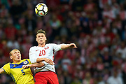 Warsaw, Poland - 2017 September 04: (R) Lukasz Piszczek from Poland fights for the ball with (L) Islambek Kuat from Kazakhstan during soccer match Poland v Kazakhstan - FIFA 2018 World Cup Qualifier at PGE National Stadium on September 04, 2017 in Warsaw, Poland.<br /> <br /> Adam Nurkiewicz declares that he has no rights to the image of people at the photographs of his authorship.<br /> <br /> Picture also available in RAW (NEF) or TIFF format on special request.<br /> <br /> Any editorial, commercial or promotional use requires written permission from the author of image.<br /> <br /> Mandatory credit:<br /> Photo by &copy; Adam Nurkiewicz / Mediasport
