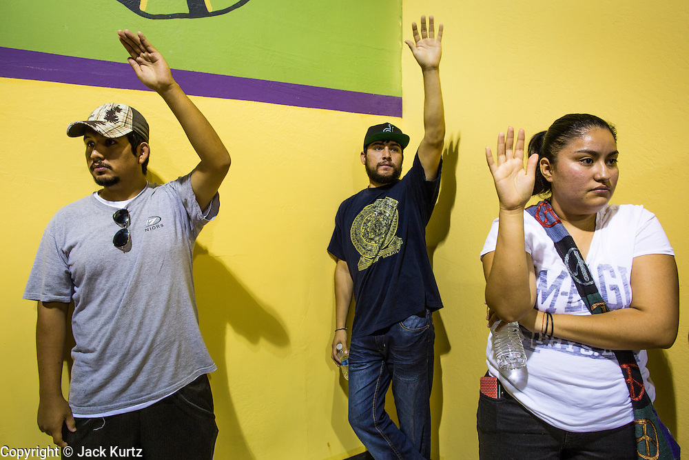 "18 AUGUST 2012 - PHOENIX, AZ:  People hold their hands up waiting to receive information packets at a deferred action workshop in Phoenix. More than 1000 people attended a series of 90 minute workshops in Phoenix Saturday on the ""deferred action"" announced by President Obama in June. Under the plan, young people brought to the US without papers, would under certain circumstances, not be subject to deportation. The plan mirrors some aspects the DREAM Act (acronym for Development, Relief, and Education for Alien Minors), that immigration advocates have sought for years. The workshops were sponsored by No DREAM Deferred Coalition.  PHOTO BY JACK KURTZ"