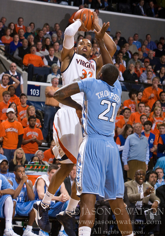 Virginia forward Mike Scott (32) shoots over North Carolina forward Deon Thompson (21).  The the #5 ranked North Carolina Tar Heels defeated the Virginia Cavaliers 83-61 in NCAA Basketball at the John Paul Jones Arena on the Grounds of the University of Virginia in Charlottesville, VA on January 15, 2009.