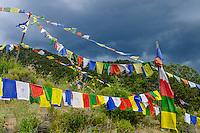 Tibetan Buddhist prayer flags waving in the breeze outside Buddhist Stupa; Crestone, CO