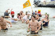 A group of people run out of the freezing Delaware River almost immediately after entering during the Polar Bear Plunge to benefit Special Olympics Saturday, January 27, 2017 at Neshaminy State Park in Bensalem, Pennsylvania. (Photo by William Thomas Cain)