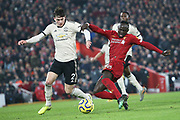 Liverpool forward Sadio Mane (10) shoots on goal Manchester United defender Victor Lindelof (2) tries to cover the shot during the Premier League match between Liverpool and Manchester United at Anfield, Liverpool, England on 19 January 2020.