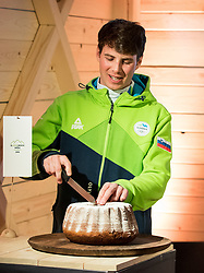 PYEONGCHANG-GUN, SOUTH KOREA - FEBRUARY 24: Bronze medalist Zan Kosir of Slovenia  cutting a potica to celebrate in Slovenia House after the Men's Parallel Giant Slalom Elimination Run on day fifteen of the PyeongChang 2018 Winter Olympic Games on February 24, 2018 in Pyeongchang-gun, South Korea. Photo by Ronald Hoogendoorn / Sportida