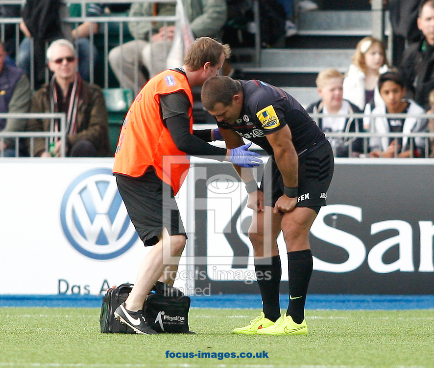 Schalk Brits of Saracens is attended to by a medic after being injured early in the game during the Aviva Premiership match at Allianz Park, London<br /> Picture by Andrew Tobin/Focus Images Ltd +44 7710 761829<br /> 11/10/2014