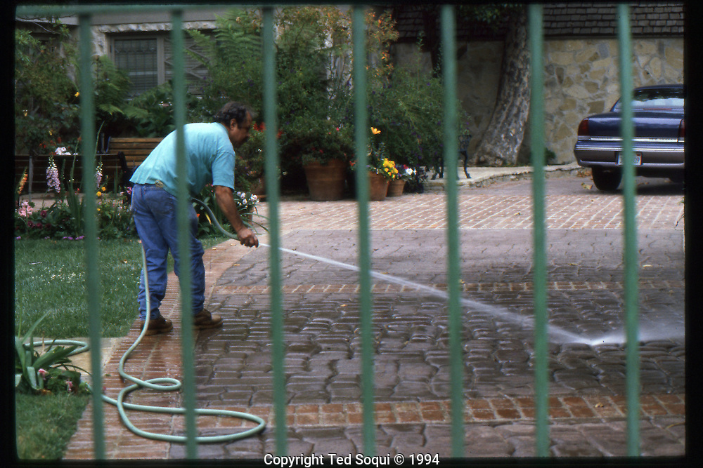 The OJ Simpson trial and media circus.<br /> A gardner washed the grounds of OJ Simpson's Brentwood home 3 days after the murders of Nicole Brown and Ron Goldman.