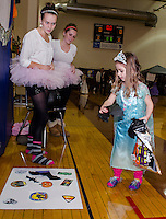 "Jillian Barton and Haleigh Patch help ""Frozen Fever"" Hayley Merriam in the Bat Toss game at Gilford Middle School's Halloween Party Friday evening.   (Karen Bobotas/for the Laconia Daily Sun)"